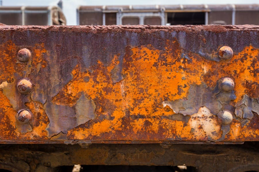 A metal beam covered in bad rust